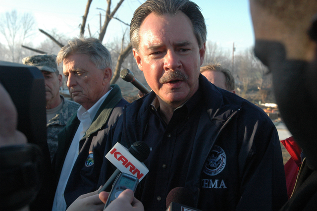 [Severe Storms, Tornadoes, and Flooding] Pope County, AR, February 8, 2008 -- R. David Paulison, Administrator of the Federal Emergency Management Agency (FEMA) speaking with reporters at a scene of destruction. Governor Mike Beebe (l) joined a tour of areas hardest hit by tornadoes.  FEMA works with state and county organizations to help local governments and individuals start the process of recovery after a Federal Disaster Declaration. Leif Skoogfors/FEMA