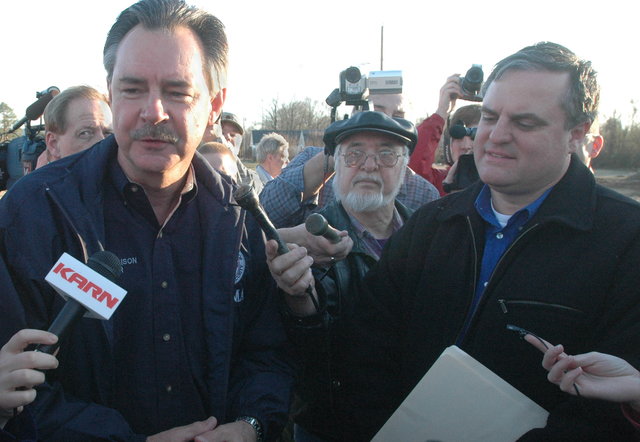 [Severe Storms, Tornadoes, and Flooding] Pope County, AR, February 8, 2008  -- R. David Paulison, Administrator of the Federal Emergency Management Agency (FEMA) speaking with reporters at one of the scenes of destruction in Arkansas. The state was hit by tornadoes, high wind storms, and flooding.  FEMA works with state and county organizations to help local governments and individuals start the process of recovery after a Federal Disaster Declaration. Leif Skoogfors/FEMA