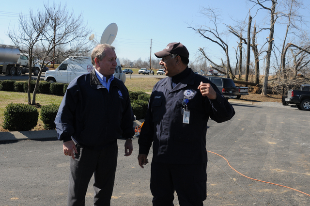 [Severe Storms, Tornadoes, Straight-line Winds, and Flooding] Lafayette, TN, February 8, 2008 -- FEMA Regional Director Phil May(left) and Willie Womack, Emergency Response Officer of FIRSTeam Atlanta confer prior to team departure. The FIRSTeam is the first FEMA presence at disaster sites and missioned to provide FEMA headquarters immediate video flow to aid initial planning and response. George Armstrong/FEMA