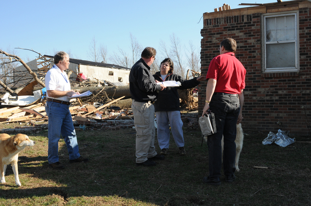 [Severe Storms, Tornadoes, Straight-line Winds, and Flooding] Lafayette, TN, February 8, 2008 -- The State/FEMA Preliminary Damage Assessment Team is talking with this homeowner regarding damage from the recent tornado. FEMA PDA Inspector Matt Sackwitz(right), State PDA Inspector Richard Taylor(center) and SBA Inspector Dennis Ayers will compile data to determine an estimate of cost to recover from this disaster.  George Armstrong/FEMA