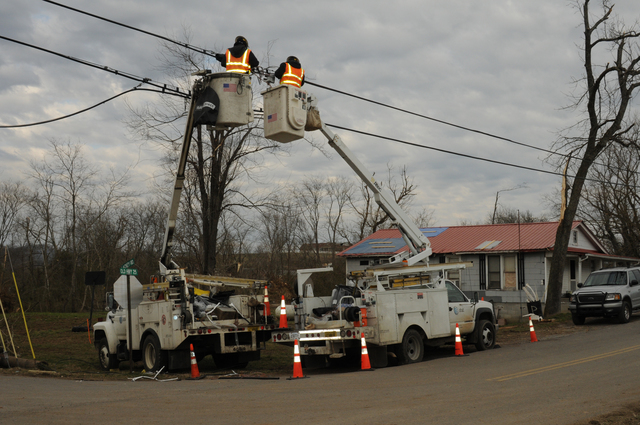 [Severe Storms, Tornadoes, Straight-line Winds, and Flooding] Castalian Springs, TN, February 11, 2008 -- Linemen are working to restore services.  Many homes were damaged and 7 fatalities in Sumner County resulted from the recent tornado in TN.  George Armstrong/FEMA