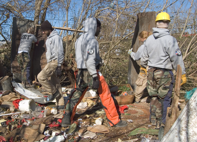 [Severe Storms, Tornadoes, Straight-line Winds, and Flooding] Lafayette, TN, 02/19/2008 -- An AmeriCorps*NCCC team clears away debris that was a storage shed behind a home destroyed by Feb. 5 tornadoes that swept across Tennessee.  The youth volunteers take part in a year-of-service and come from across the nation to serve. Tim Tyson/FEMA
