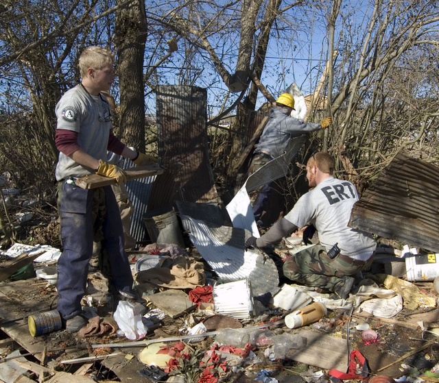 [Severe Storms, Tornadoes, Straight-line Winds, and Flooding] Lafayette, TN, 02/19/2008 -- AmeriCorps Emergency Team (ERT) members based in Mobile, Alabama, remove debris from a home destroyed by an EF4 tornado that struck Macon County, Tennessee Feb. 5. The regionally-based volunteers join other AmeriCorps youth to assist in debris removal and other recovery tasks in similar disasters. Tim Tyson/FEMA