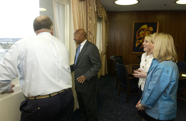 Visit of DeAntonio Family to HUD - Nicola DeAntonio, Executive Assistant in the Office of the Secretary, and family members, Pasquale and Bonnie,  at HUD Headquarters with Secretary Alphonso Jackson, staff