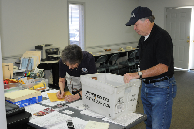 [Severe Storms, Tornadoes, Straight-line Winds, and Flooding] Thompkinsville, KY, March 2, 2008 -- FEMA Disaster Recovery Center (DRC) Manager Jane Kennedy prepares a communication to send by FEMA Logistics Specialist Jerry Schauer who provides courier service to the Monroe County Disaster Recovery Center from the FEMA Joint Field Office in Lexington. FEMA is here due to severe storm and tornado.  George Armstrong/FEMA