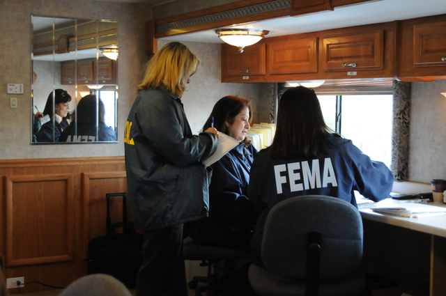 [Severe Storms, Tornadoes, Straight-line Winds, and Flooding] Lexington, KY, March 3, 2008 -- FEMA Disaster Recovery Center Manager (DRC) Vivian Barrios provides information to FEMA Community Relations (CR) Specialists Maureen Ivey and Miriam Stack prior to the DRC opening today. FEMA is here due to severe storm and tornado affecting Fayette and other KY counties.  George Armstrong/FEMA