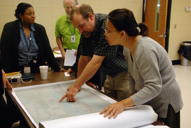 [Hurricane Katrina] Biloxi, MS, March 19, 2008 -- Biloxi floodplain manager Richard Stickler shows a flood map to Mai Trinh at a meeting for the Vietnamese community. Translators were present to help local Vietnamese citizens understand the new maps. Jennifer Smits/FEMA