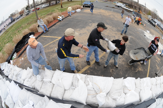 [Severe Storms and Flooding] Fenton, MO, March 21, 2008 -- Local residents and area volunteers band together to fill sand bags and stack them next to businesses and property on the Meramec River.  Jocelyn Augustino/FEMA