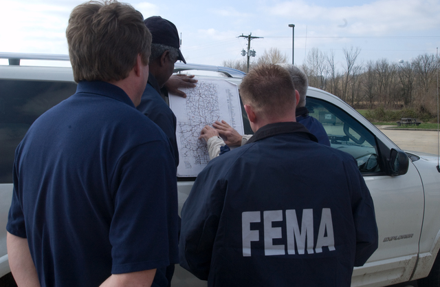 [Severe Storms and Flooding] Bollinger County (Marble Hills), MO, March 22, 2008 -- The Chicago FIRST team meets with the Bollinger County Emergency Manager to survey flood damage and determine a location to place a mobile command office to support the upcoming joint damage assessments.  FEMA/John Shea