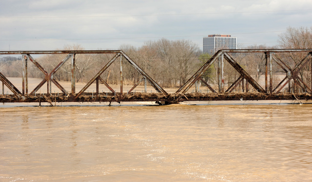 [Severe Storms and Flooding] Valley Park, MO, 03/23/2008 -- A railraod bridge over the Meramec River is covered with debris following the recent rise in the river.  Jocelyn Augustino/FEMA