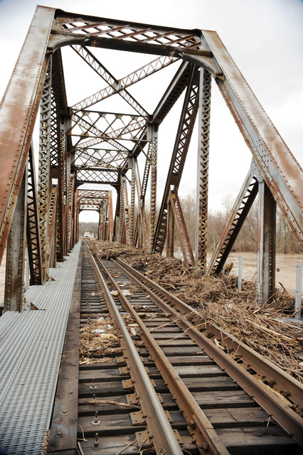 [Severe Storms and Flooding] Valley Park, MO, 03/23/2008 -- A railroad bridge over the Meramec River is covered with debris following the recent rise in the river.  Jocelyn Augustino/FEMA