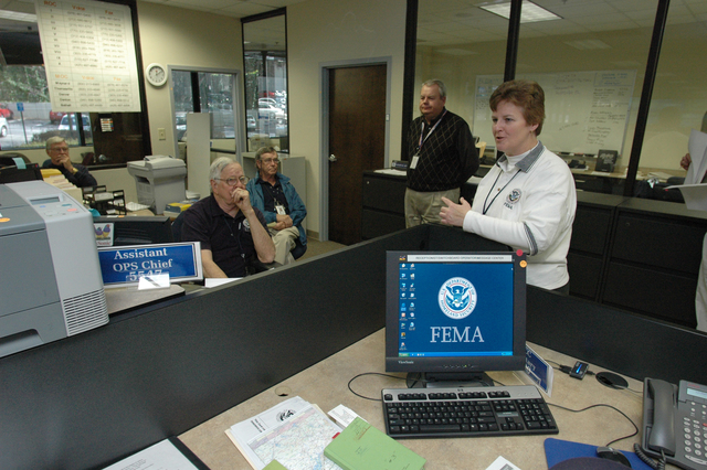 [Severe Storms and Tornadoes] Atlanta, GA, March 24, 2008 -- Libby Turner, Federal Coordinating Officer, (FCO) for the Federal Emergency Management Office's (FEMA) recovery efforts in Georgia meeting with FEMA staff.  Atlanta suffered damage after a tornado hit the city center. FEMA will provide help to individuals, businesses, and local governments for recovery. Leif Skoogfors/FEMA