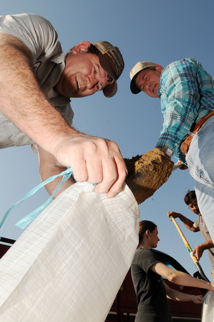 [Severe Storms, Tornadoes, and Flooding] Des Arc, AR, March 25, 2008 -- Members of the community band together to fill sandbags for an operation going on near a levee in an area called Sandhill.  Jocelyn Augustino/FEMA