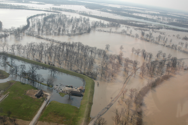 [Severe Storms, Tornadoes, and Flooding] Northeastern Arkansas, AR, March 26, 2008 --  Agricultural land is flooded by the Black River after torrential rains.  FEMA assesses the damage caused by the flooding to help determine if federal assistance is required.  FEMA/Samir Valeja