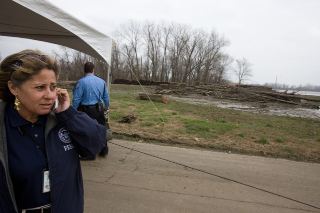 [Severe Storms and Flooding] Cape Girardeau, MO, March 27, 2008 -- FEMA Representative Carmen Rodriguez views damage in Cape Girardeau area.  FEMA is there to help residents recover from recent flooding.  Andrea Booher/FEMA