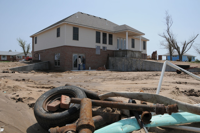 [Severe Storms, Tornadoes, and Flooding] Greensburg, Kansas, April 25, 2008 -- A new home being built in Greensburg one year after a tornado destroyed the town. Debris remains in the street as Greensburg slowly recovers. FEMA photo/ John Shea.
