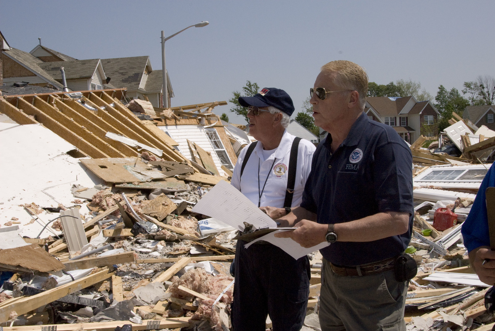 Sufflok, VA, 5/01/2008 --  FEMA specialist Joe Pickering with Bill Young from the Small Business Administration look at damage as they do a preliminary damage assessment in the Hillpoint subdivision that was hit by a severe tornado a few days ago. Photo By: Liz Roll/FEMA