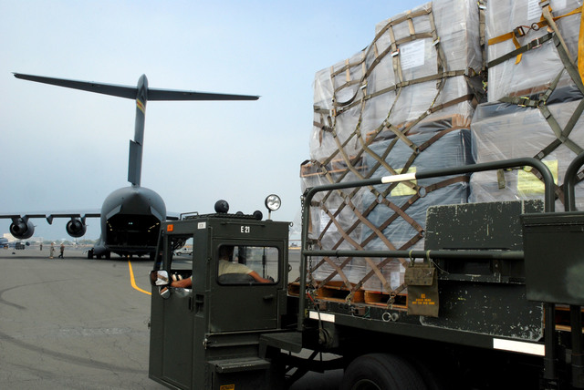 Hickam AFB, HI, May 17, 2008 -- FEMA supplies from the Pacific Distribution Center are  loaded on a C-17 to provide requested aid to China following an earthquake there. FEMA is assisting other federal agencies with the international aid request. FEMA Photo/ Kenneth Tingman.