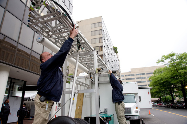 Washington, DC, May 20, 2008 -- FEMA employees Michael Dean and Michael Mihelich prepare a radio tower for deployment at FEMA headquarters to demonstrate FEMA's operation.  FEMA is hosting their First Hurricane Awareness Day at FEMA headquarters to highlight the federal government's preparations for the 2008 Hurricane Season.  FEMA/Bill Koplitz