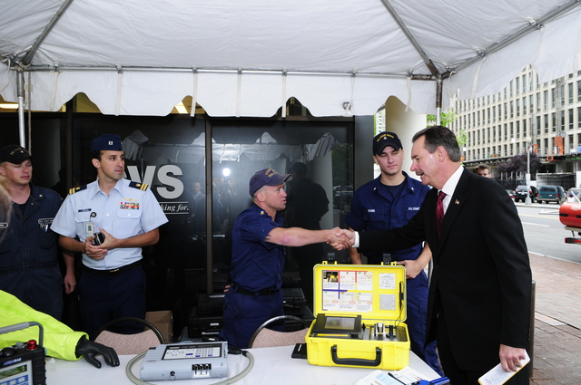 Washington, DC, May 20,2008 -- FEMA Administrator R. David Paulison, thanks the US Coast Guard for their work and display booth.  The display was part of Hurricane Awareness Day events at FEMA Headquarters in the District of Columbia.  Barry Bahler/FEMA