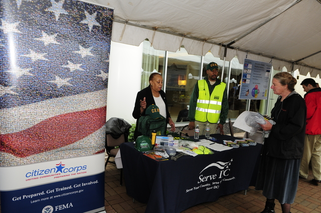 Washington.DC. May 20, 2008 -- Representatives from Serve DC, a member of Citizen Corps, staff the Hurricane Awareness Day booth at FEMA Headquarters.  The display was open to the public.  Barry Bahler/FEMA