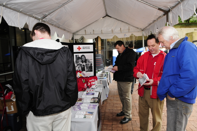 Washington,DC, May20,2008 --  An American Red Cross volunteer explains their program to people visiting their display during FEMA's Hurricane Awareness Day. This special event was hosted at FEMA Headquarters, in the District of Columbia.  Barry Bahler/FEMA