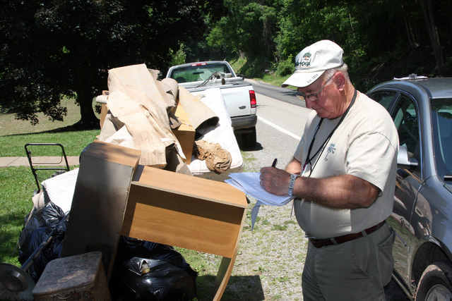 [Severe Storms, Tornadoes, and Flooding] Gilmer County, WV, June 7, 2008 -- Local Representative Jim Duffield is part of the Preliminary Damage Assessment (PDA) Team surveying damages to multiple counties in West Virginia due to flooding from three consecutive storms. Representatives from FEMA, SBA and the State are included in the fact finding team to determine the extent of damage in the area. Robert Kaufmann/FEMA