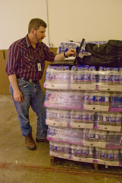 [Severe Storms, Tornadoes, and Flooding] Mason City, IA, June 11, 2008 -- Ed Crow, a FEMA representative accounts for the  pallets of bottled water that have been provided to the residents of Mason City, IA after their water supply was contaminated by flood waters.  Storms have inconvenienced many people throughout Iowa.  Photo by Patsy Lynch/FEMA