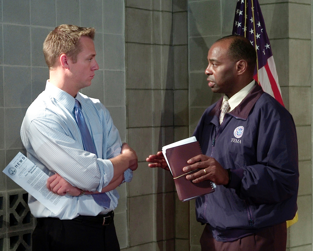 [Severe Storms, Tornadoes, and Flooding] Lincoln, NE, June 13-2008 -- FEMA Federal Coordinating Officer Willie G. Nunn (R) discusses the public assistance process with Lincoln television journalist Jason Volentine following the Nebraska governor's press conference announcing the governor's request for a federal disaster declaration.  FEMA/Louis Sohn