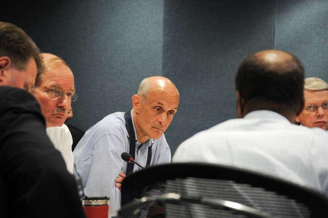 [Severe Storms, Tornadoes, and Flooding] Washington, DC, June 13, 2008 -- DHS Secretary Michael Chertoff with FEMA's Deputy Administrator Harvey Johnson at the FEMA video teleconference at FEMA headquarters.  Bill Koplitz/FEMA
