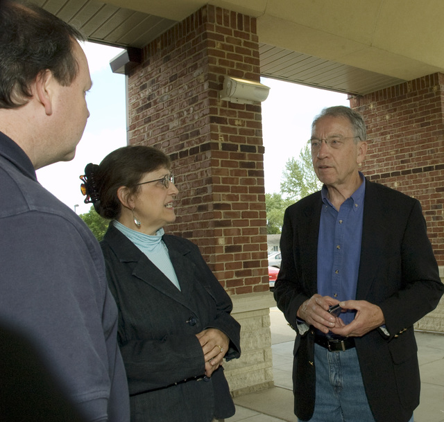 [Severe Storms, Tornadoes, and Flooding] Waverly, IA, June 14, 2008 -- Senator Chuck Grassley, R-IA meets with FEMA Congressional representative Jodi Bruckner before a town hall meeting in Waverly, IA  with residents affected by  recent flooding.  He and Senator Tom Harkins, D-IA  meet with local residents to hear their concerns about the recovery efforts being conducted by FEMA and state and local agencies.  Photo by Patsy Lynch/FEMA