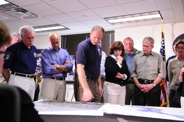 [Severe Storms, Tornadoes, and Flooding] Cedar Rapids, IA, June 19, 2008 -- FEMA's Region VII Administrator, Richard Hainje, briefs President Bush, on the Iowa flooding, prior to an aerial tour.  Department of Homeland Security Secretary, Michael Chertoff is on left (light blue shirt) and Iowa City mayor, Regenia Bailey is on right (black sweater).  Barry Bahler/FEMA