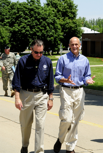 [Severe Storms, Tornadoes, and Flooding] Cedar Rapids, IA, June 19, 2008 -- (L-R) FEMA Administrator, R. David Paulison; Department of Homeland Security Secretary, Michael Chertoff, discuss the flooding in Iowa, as they walk to Marine 1 to view the disaster from the air with the President.  Barry Bahler/FEMA