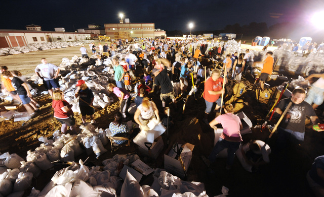 Winfield, MO, 06/19/2008 -- Local volunteers prepare sandbags into the evening hours at a local high school to help sandbagging efforts on the local levees in anticipation of breaching of the levees on June 19, 2008.  Jocelyn Augustino/FEMA