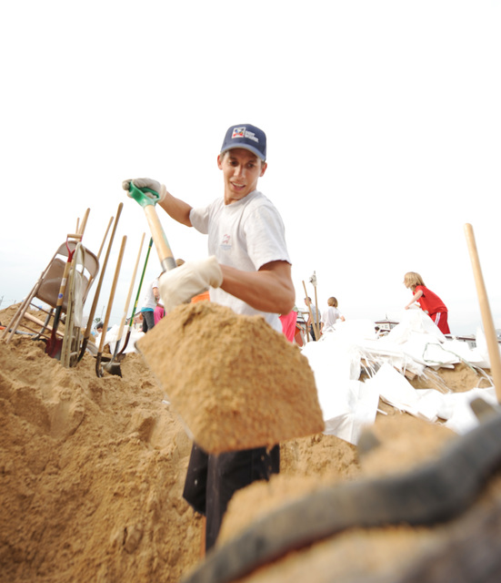 Winfield, MO, June 19, 2008 -- A local volunteer fills a sandbag at a local high school to help for sandbagging efforts at the local levees  on June 19, 2008.  Jocelyn Augustino/FEMA