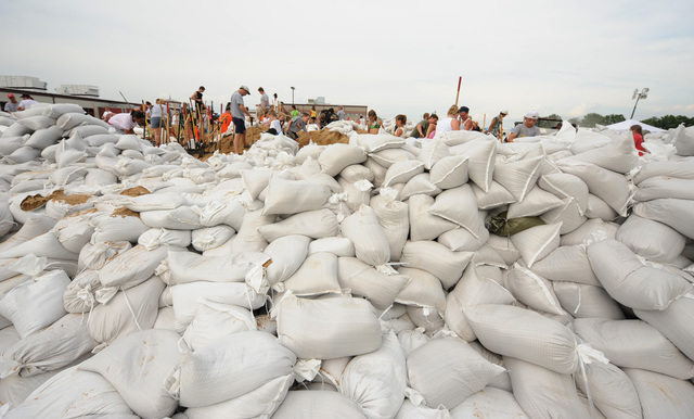 Winfield, MO, June 19, 2008 -- Local volunteers prepare sandbags at a high school to help sandbagging efforts at the local levees.  Jocelyn Augustino/FEMA