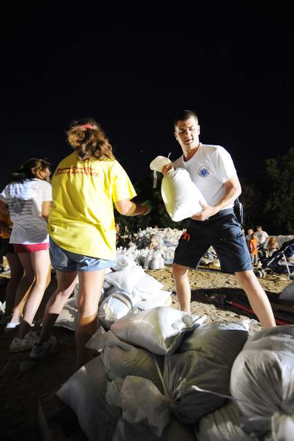 Winfield, MO, June 19, 2008 -- Local volunteers prepare sandbags into the evening hours  at a local high school to help  sandbagging efforts on the local levees in anticipation of breaching of the levees on June 19, 2008.  Jocelyn Augustino/FEMA