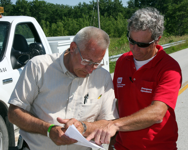 [Severe Storms, Tornadoes, and Flooding] Quincy, IL, June 20, 2008 -- Dick Klusmeyer, Adams County Engineer for Illinois and Jimmy Aidale from the US Army Corps of Engineers, Emergency Operations review a list of the counties affected by the currently rising flood waters in lower Illinois. Robert Kaufmann/FEMA