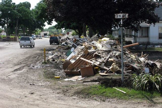 [Severe Storms, Tornadoes, and Flooding] Vinton, IA, June 20, 2008 -- Debris is piled throughout town as residents pull up and throw out waterlogged possessions from last Thursday's flooding of the Cedar River.  Benton County was just designated as a disaster county.  Photo by Greg Henshall / FEMA