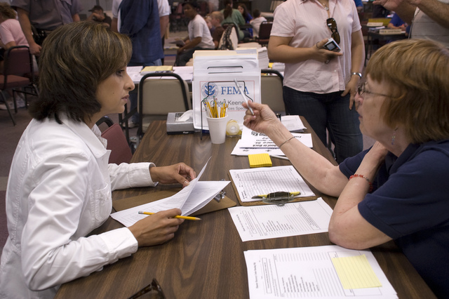 [Severe Storms, Tornadoes, and Flooding] Waterloo, IA, June 20,2008 -- Undersecretary For Agriculture, Nancy Montanez-Johner talks with Gretel Keene, a FEMA representative at the Disaster Recovery Center in Waterloo.  Montanez-Johner was visiting Iowa to see what types of services are being provided to the citizens of Iowa.  Photo by Patsy Lynch/FEMA