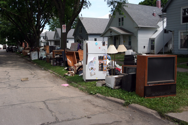 [Severe Storms, Tornadoes, and Flooding] Cedar Rapids, IA, June 23, 2008 -- Debris, trash, electronics, household items, appliances, and even kitchen sinks line side streets in downtown Cedar Rapids neighborhoods one week after the record flood of 2008.  The city estimates it will collect 400,000 tons by the end of the Summer.  Photo by Greg Henshall / FEMA