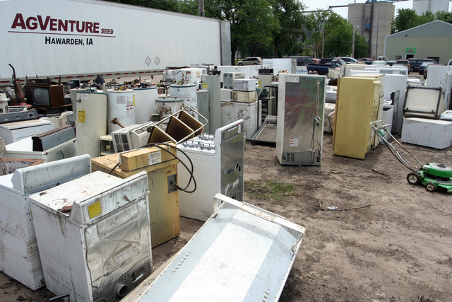 [Severe Storms, Tornadoes, and Flooding] New Haven, IA, June 24, 2008 -- Dozens of home appliances were hauled to a lot on Broadway Street when the water began receding from the June 9 flooding of Beaver Creek.  Refrigerators, freezers, stoves, water heaters, and other household items sit awaiting the junk man.  Photo by Greg Henshall / FEMA