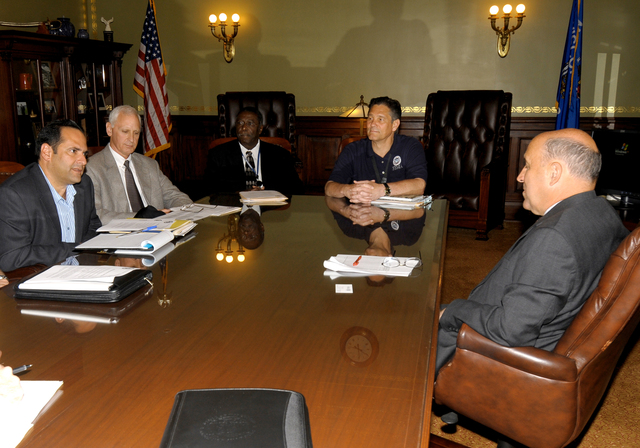 Madison, WI - FEMA Assistant Administrator for Disaster Assistance Carlos Castillo (left) briefs Wisconsin Governor Jim Doyle (right) on the recovery efforts now underway in the state. Also attending the briefing and providing the governor with updates are (left to right): FEMA Region 5 Administrator Edward G. Buikema; Wisconsin Emergency Management Administrator Johnnie Smith; and FEMA Federal Coordinating Officer Dolph Diemont.  FEMA photo by Win Henderson