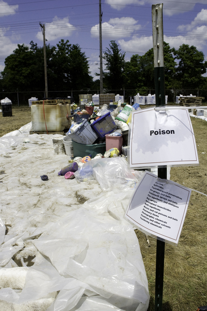 [Severe Storms, Tornadoes, and Flooding] Cedar Rapids, Iowa, July 4, 2008 -- Poisonous household items are sorted at the EPA staging area in Cedar Rapids. These items are collected from around the city and brought here. The EPA is responsible for the proper disposal of them. Susie Shapira/FEMA