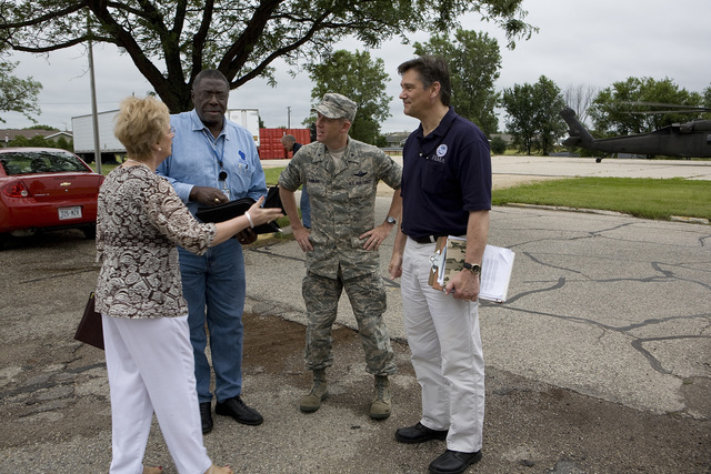 [Severe Storms, Tornadoes, and Flooding] Janesville, WI, July 8, 2008 -- Rock County Emergency Manager Shirley Conners greets State Coordinating Officer Johnnie Smith, Wisconsin Adjutant General Donaldd Dunbar and Federal Coordinating Officer Dolph Diemont at a fly-in to listen to local officials' concerns.  FEMA  personnel work closely with the state and local officials in a disaster situation.  Photo by Ed Edahl/FEMA
