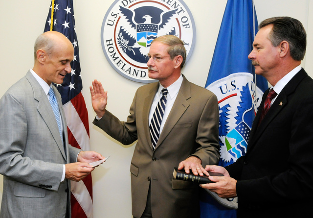 WASHINGTON, DC, July 14, 2008 -- Department of Homeland Security Secretary Michael Chertoff swears in Harvey Johnson, Jr., as Deputy Administrator and Chief Operating Officer of the Federal Emergency Management Agency in a ceremony held at DHS Headquarters in Washington, DC. DHS photo by Mike Lutz