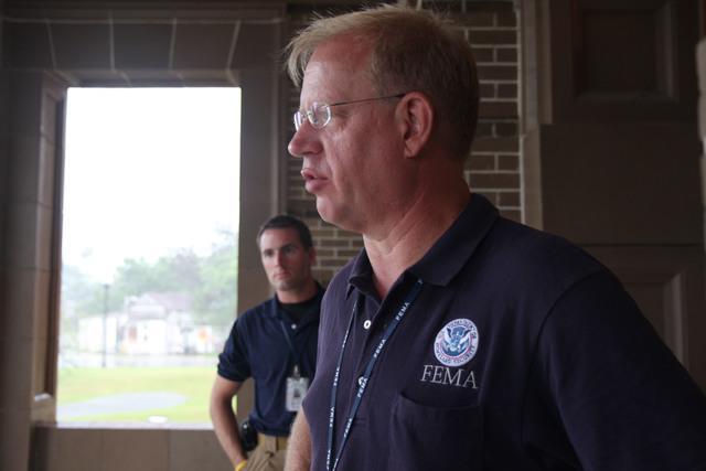 [Hurricane Dolly] Brownsville, TX, July 23, 2008 -- FEMA officials (front: Robert Alvey Region VI External Affairs; and Derek Shackelford Region VI Division Coordinator)at the EOC (Emergency Operations Center), preparing for Hurricane Dolly. Jacinta Quesada/FEMA