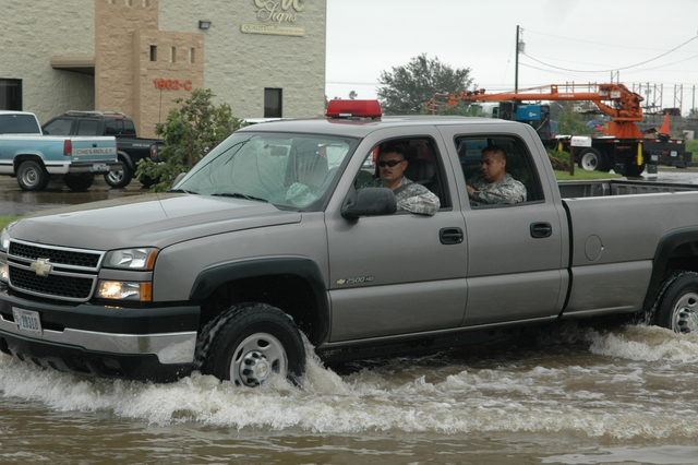 [Hurricane Dolly] Welasco, TX, July 24, 2008 --  Texas Army National Guardsmen drive the flooded streets of this Hildago County community in a pick up truck and offer assistance to the residence in need.  Barry Bahler/FEMA