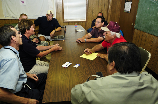 [Hurricane Dolly] Raymondville, TX, July 26, 2008 -- FEMA's Sandy Coachman, Federal Coordinating Officer (FCO) second from left - navy blue shirt, participates in a meeting with state and local officials during Saturday meetings concerning recovery actions for Hurricane Dolly.  Visible participants seated L-R: Frank Cantu, State Coordinating Officer (SCO); Coachman; Elearza Garcia; City Manager; Frank Torres, Willacy County, Emergency Management Coordinator; Emilo Vera, Intrim-County Judge and Orlando Correa, Raymondville Mayor.  Barry Bahler/FEMA
