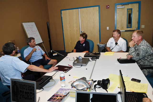 [Hurricane Dolly] South Padre Island,TX, July 26, 2008 --  (L-R) Frank Cantu, Texas State Coordinating Officer (SCO); Robert N. Pinkerton,Jr., Mayor; Sandy Cashman, FEMA Federal Coordinating Officer (FCO); Burney Baskett, City Fire Chief/Emergency Management Coordinator; Lt. Col. Travis Grigg, US Army North, DOD Coordinating Officer, discuss the recovery status on the Island.  Barry Bahler/FEMA